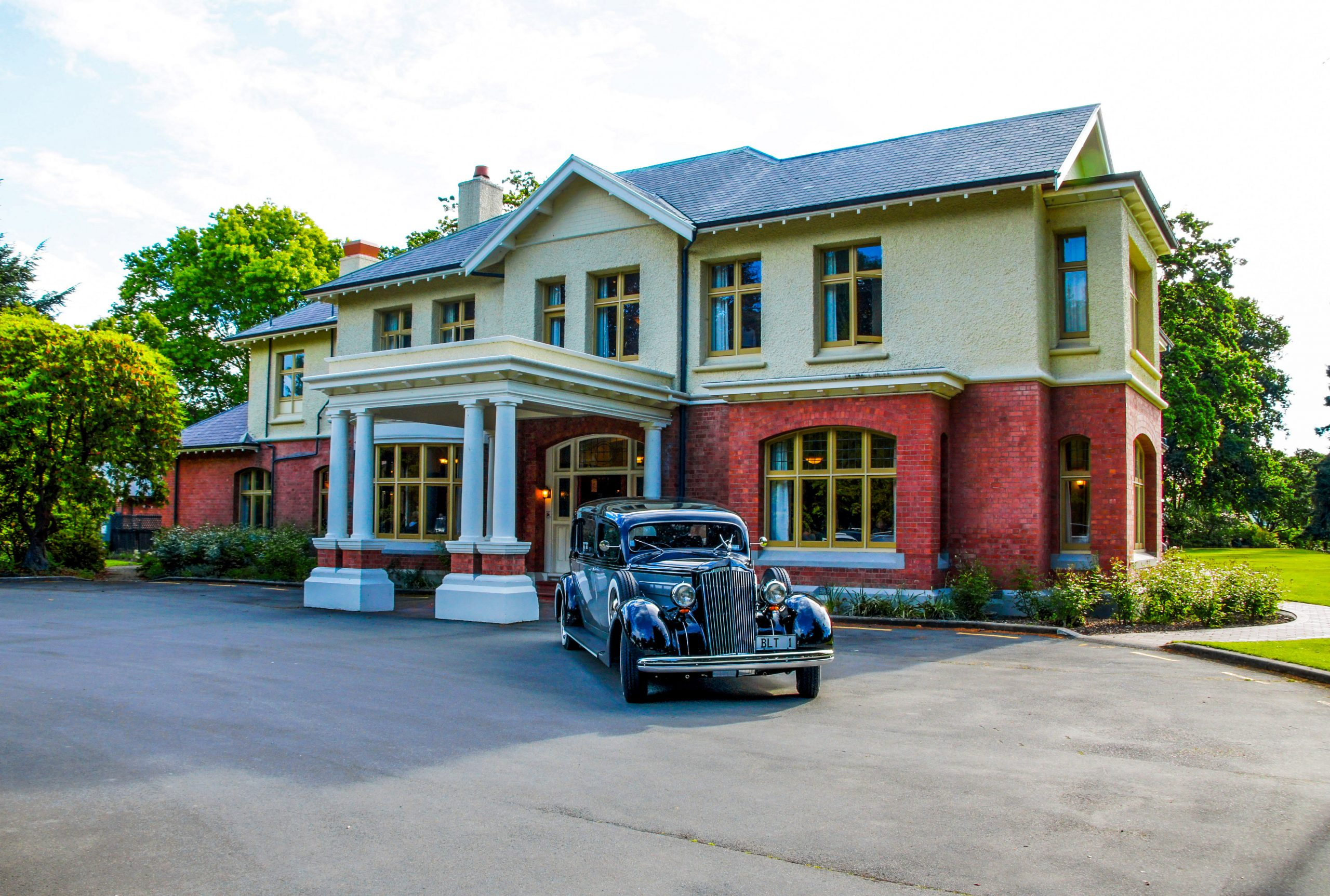 Ilam Homestead with car- Venues | Bell, Lamb & Trotter